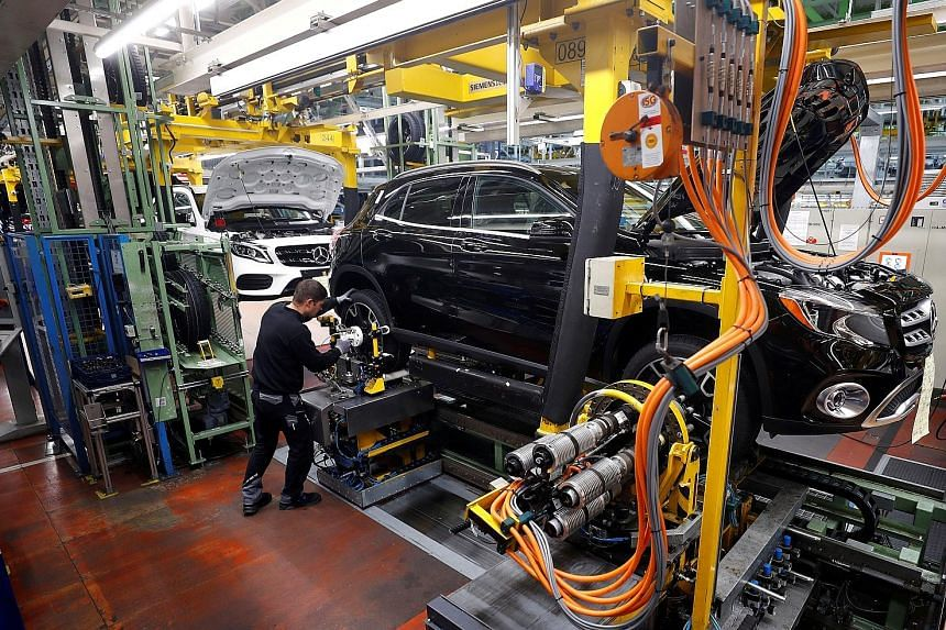 Mercedes-Benz vehicles at a factory in Rastatt, Germany. A 25 per cent US levy on foreign cars would have added €110,000 (S$165,160) to the sticker price of EU vehicles imported into the United States, according to the Brussels-based European Commi