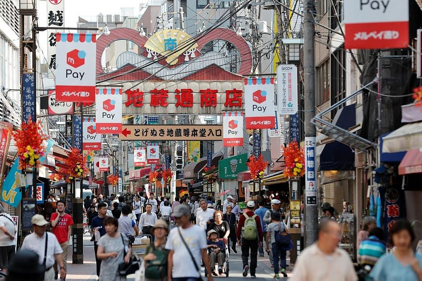 Japan's economic growth likely slowed to an annualised 0.8 per cent in July-September from 1.3 per cent in the second quarter, a Reuters poll showed this week. PHOTO: REUTERS
