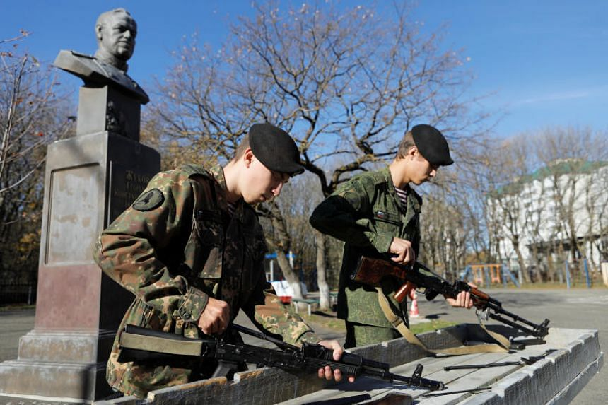At Victory Museum in western Moscow, visitors including the young cadets are invited to assemble Kalashnikovs and pose for selfies at the exhibition dedicated to the ubiquitous automatic weapon.