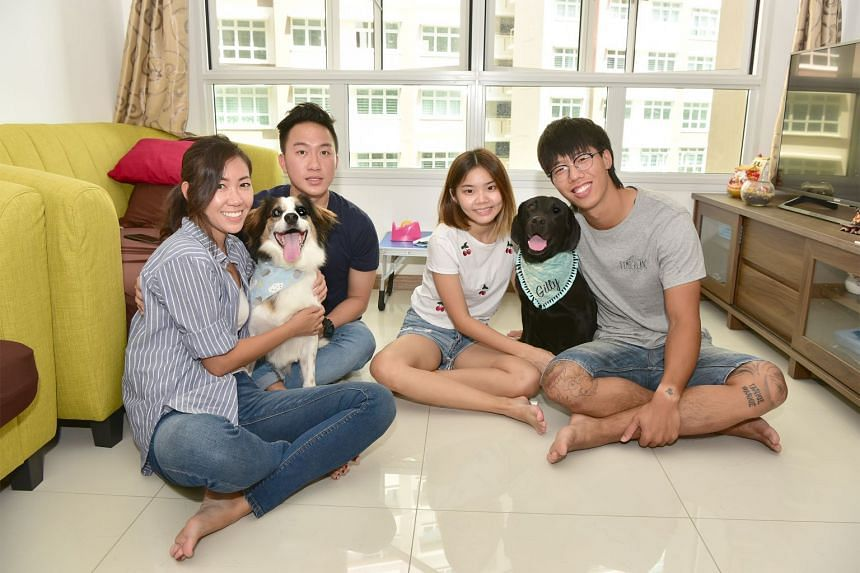Captain Anne Claudine Tan, Jimbob, Lieutenant Jonathan Ong, Mr Jonathan Leow's girlfriend Koh Tian Ning, Gilly, Mr Jonathan Leow, two dog owners from the SPF and SCDF, who had adopted dogs under the pilot programme last year. Photo taken on Aug 16, 2