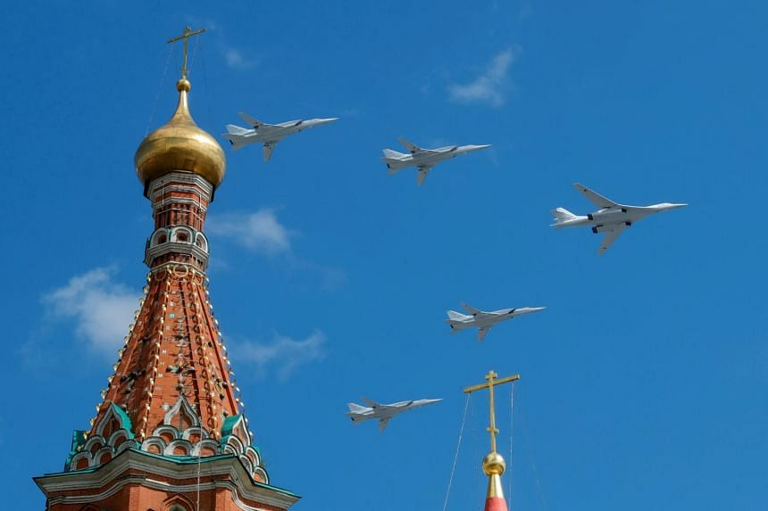 Russian army Tupolev Tu-160 and Tupolev Tu-22M3 fly in formation over St. Basil's Cathedral during the rehearsal for the Victory Day parade in Moscow, Russia, on May 4, 2019.