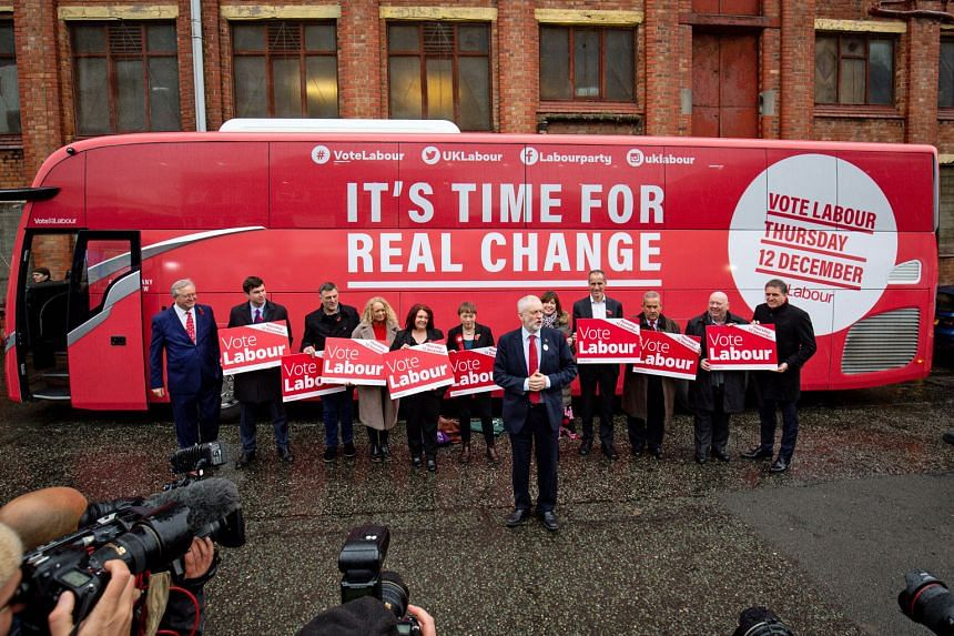 Britain's Labour Party leader Jeremy Corbyn unveiling the party's campaign bus during a campaign trail on Thursday, ahead of the general election.