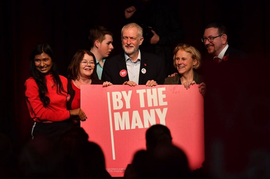 British opposition leader Jeremy Corbyn with Labour Party activists at an election event in England this week. In the event of a hung Parliament, Mr Corbyn is seen as having more potential allies among the smaller parties.