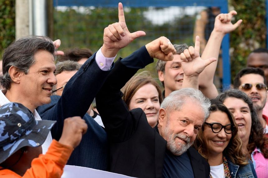 Lula gestures as he leaves the Federal Police Headquarters in Curitiba, Brazil, on Nov 8, 2019.