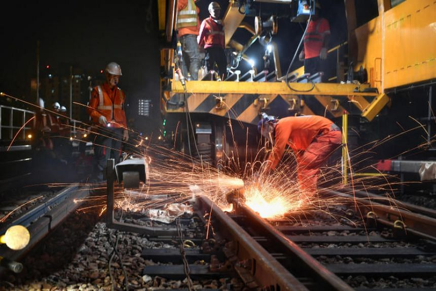 Engineers carrying out rail replacement works at Boon Lay MRT Station, on Sept 9, 2018.