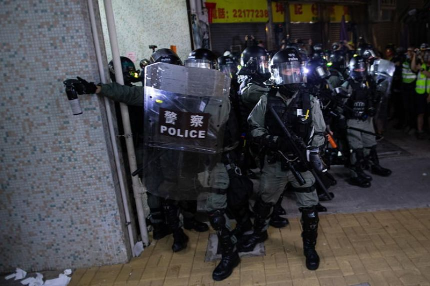Anti-riot police preparing to use pepper spray during a rally in Hong Kong, China, on Nov 9, 2019.