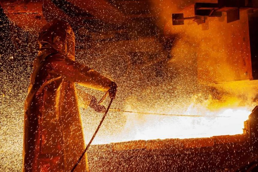 A photo taken on March 30, 2019, showing a worker manning a furnace during a nickel smelting process at a plant in Soroako, Indonesia.