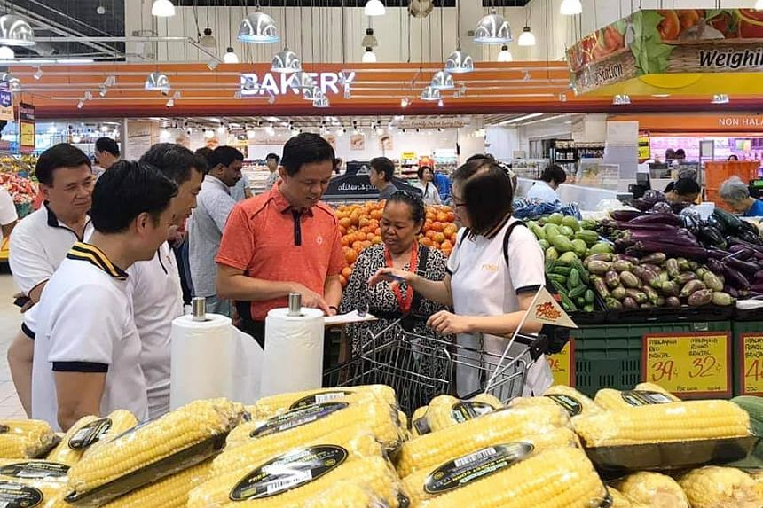 Mdm Nor Maimon Binte Ismail interacting with Minister for Trade and Industry Chan Chun Sing at a Giant Hypermart in Tampines, on Nov 9, 2019.