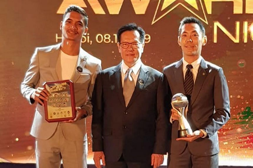 FAS president Lim Kia Tong (centre) with Safuwan Baharudin (left) and Ronnie Koh at the AFF Awards in Hanoi, on Nov 8, 2019.