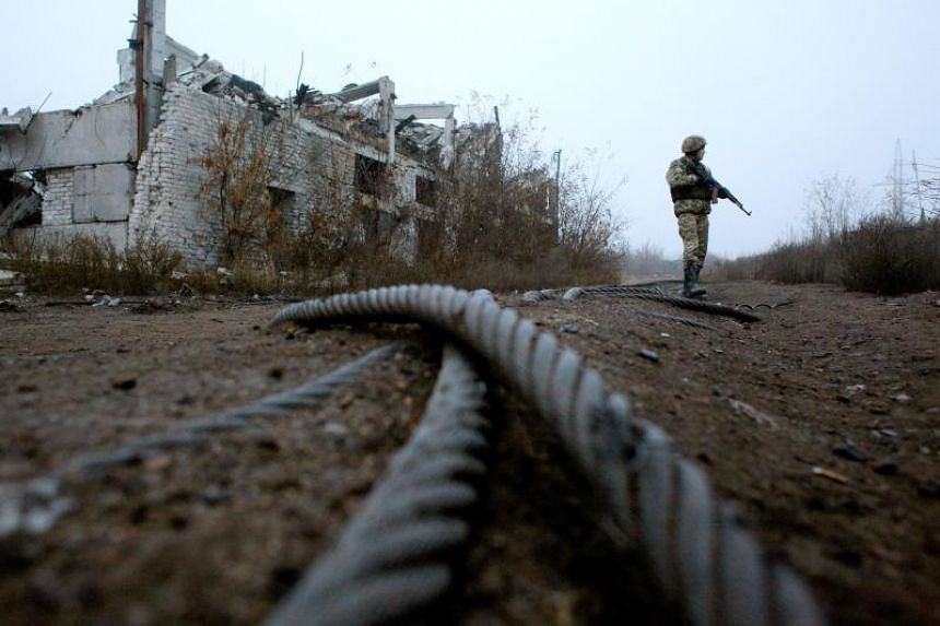 A Ukrainian serviceman patrolling at a destroyed coal mine near the town of Avdiivka, Ukraine, on Nov 7, 2019.