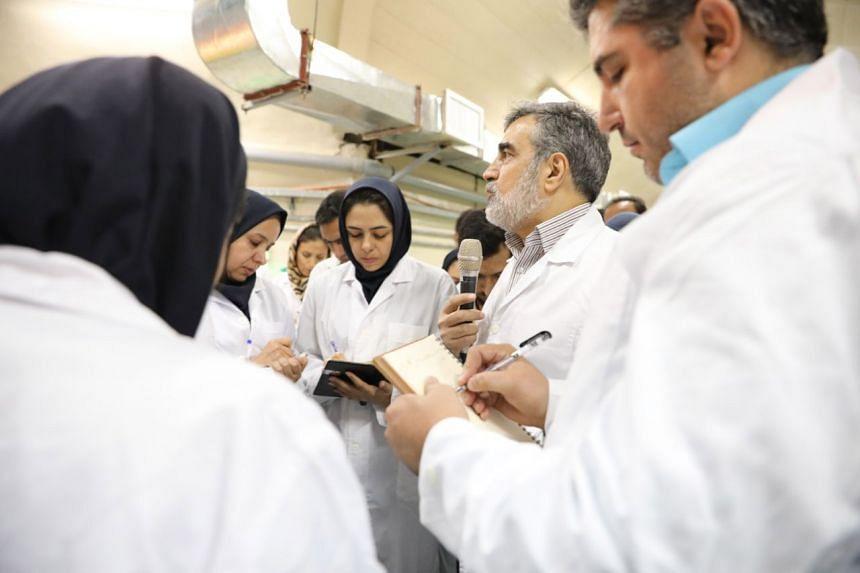 AEOI spokesman Behrouz Kamalvandi (second right) addresses local journalists at Iran's Fordow nuclear facility.