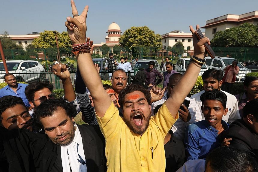 Hindu devotees outside the Supreme Court in New Delhi yesterday after the court awarded custody of a disputed site in Ayodhya to a government-appointed trust that will be made up of Hindu representatives. Legal conflict between Muslim and Hindu group