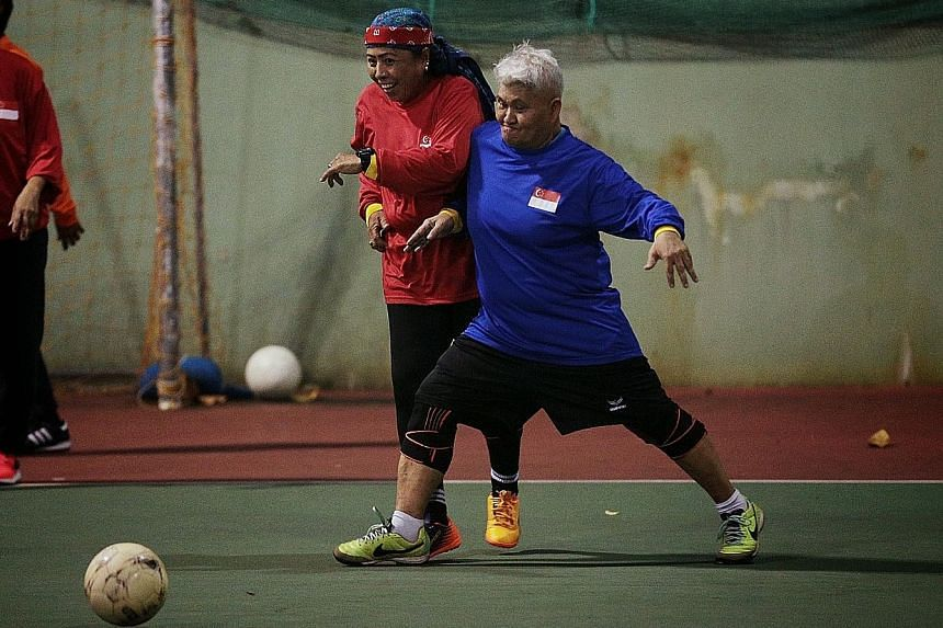 Sexagenarians Maimun Wahab (in blue) and Merah Ahmad challenging for the ball during a walking football session at Evans Road last month. They are part of 4 Ever Young The Legends, a team comprising former national women's footballers who come togeth