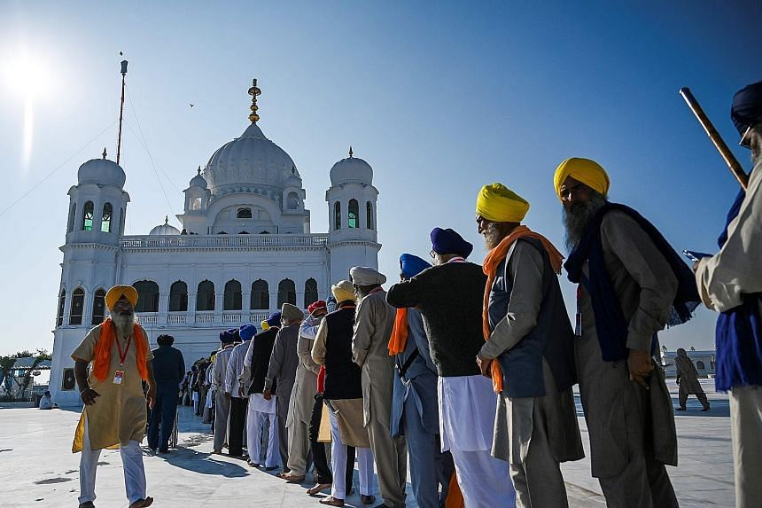 Pilgrims queueing yesterday to visit the shrine of Sikhism's founder Guru Nanak in Kartarpur, Pakistan, after a landmark deal that allows Indian Sikhs access to one of their religion's holiest sites.