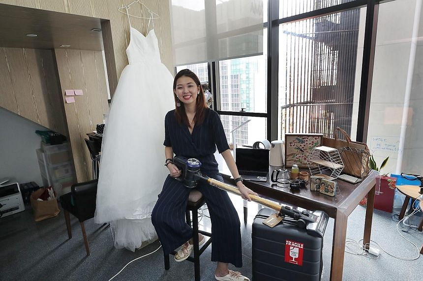 Bride-to-be Lynn Yang, founder of creative agency Project WXY, with her online purchases in her office on Thursday. She intends to buy wedding items on shopping site Taobao at the stroke of midnight today, when many things go on sale for Singles Day.