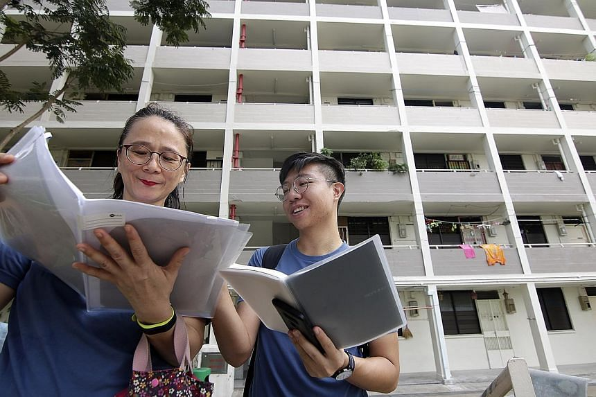Architecture researcher Jeremy John Kum, 24, and volunteer guide Betty Huang, 52, from civic group My Community, which produced a heritage assessment report on the homes in Stirling Road. The 34-page report has been submitted to the Urban Redevelopme
