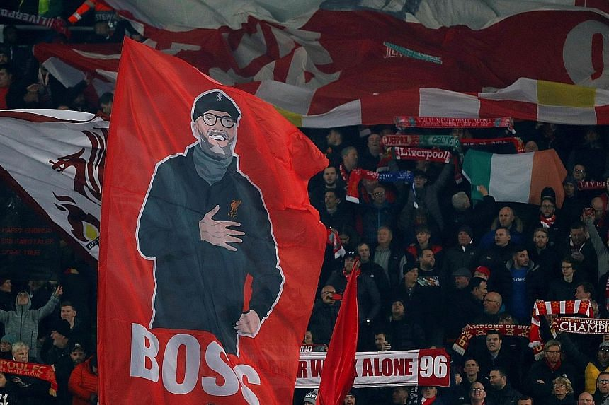 Liverpool fans holding up a banner of manager Jurgen Klopp before the Champions League match against Genk at Anfield on Wednesday.