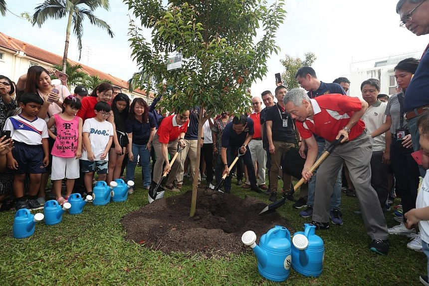 Prime Minister Lee Hsien Loong planted a tree near the Countryside Playground in Yio Chu Kang yesterday, as part of the Ang Mo Kio GRC and Sengkang West SMC Tree Planting Day. He was joined by Dr Koh Poh Koon (far left, in red), Senior Minister of St