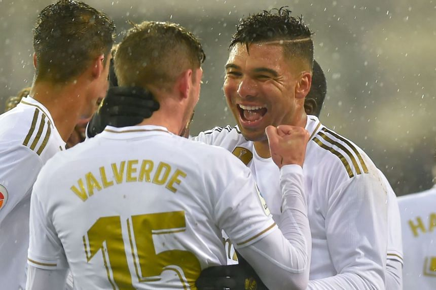 Real's Valverde (centre) celebrates with midfielder Casemiro after scoring.