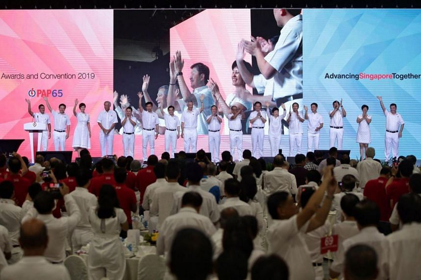 PM Lee Hsien Loong, DPM Heng Swee Keat and PAP Central Executive Committee members on stage at the start of the PAP65 Awards and Convention on Nov 10, 2019.