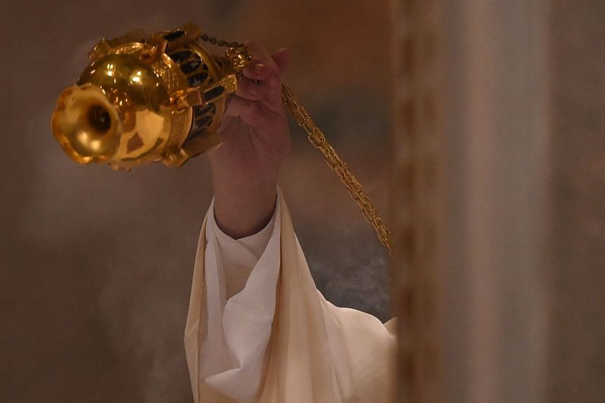 Pope Francis swings a thurible of incense during a mass at the Basilica of Saint John Lateran in Rome.