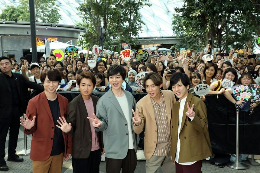 J-pop boy band Arashi greet and take pictures with fans at a press conference held at Jewel Changi Airport on Nov 10, 2019.