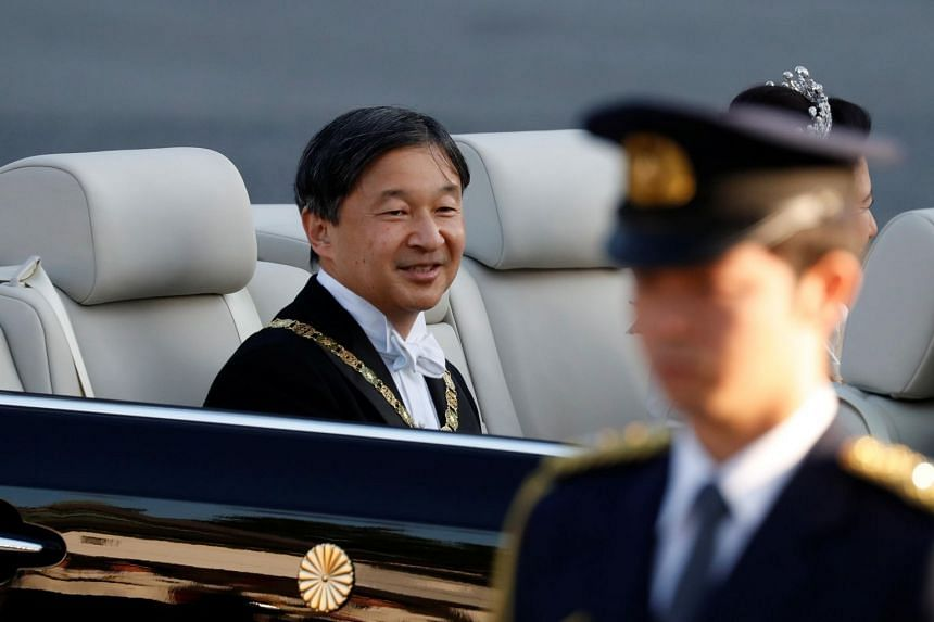 Japan's Emperor Naruhito rides in a car during a royal parade to mark his enthronement in Tokyo on Nov 10, 2019.