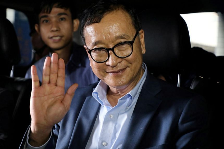 Cambodia's self-exiled opposition party founder Sam Rainsy waves before he leaves Kuala Lumpur International Airport in Sepang, Malaysia, on Nov 9, 2019.