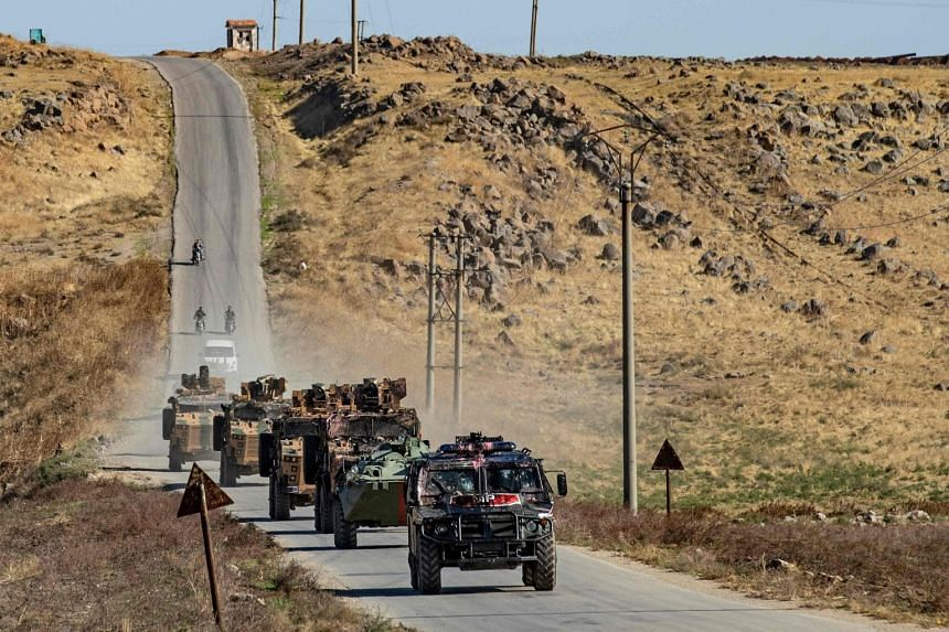 Russian and Turkish military vehicles take part in a joint Turkish-Russian patrol near the town of Al-Muabbadah in the northeastern Syrian Hassake province on the border with Turkey, on Nov 8, 2019.