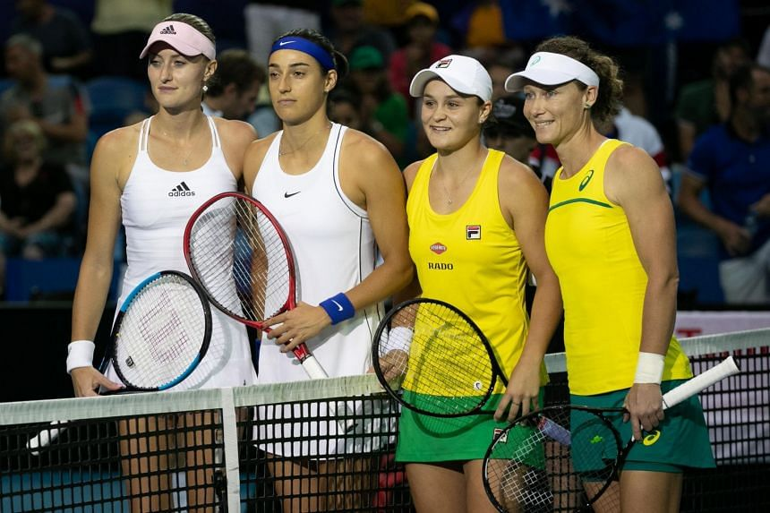 (From left) French tennis players Kristina Mladenovic and Caroline Garcia, pose for a picture with Australian tennis players Ashleigh Barty and Sam Stosur ahead of their tennis double match on day 2 of the 2019 Fed Cup between Australia and France at