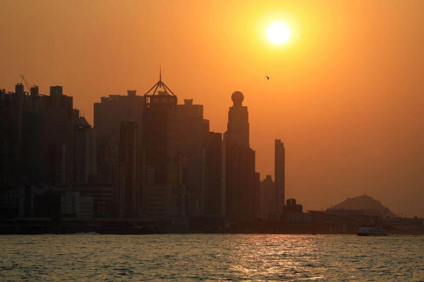The harbour skyline is seen during sunset in Hong Kong, China on Oct 18, 2019.