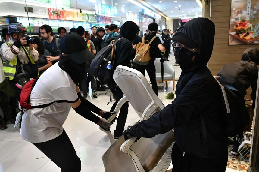 Protesters gather materials to use for a barricade at the Citywalk shopping mall in Tsuen Wan in Hong Kong on Nov 10, 2019.