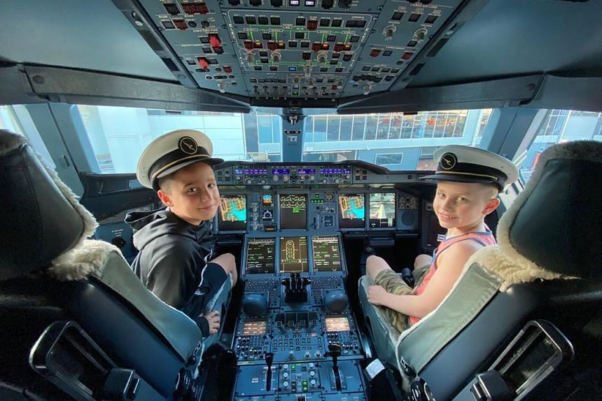 John Travolta shared on Instagram a photo of his son Ben (right) and an unnamed young pal sitting in the cockpit of a plane.