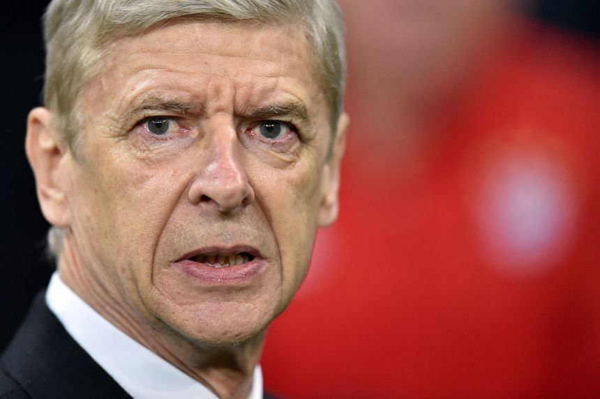 """Wenger (above) rejected Bayern's version of events and criticised the club for leaking """"rumours from everywhere""""."""