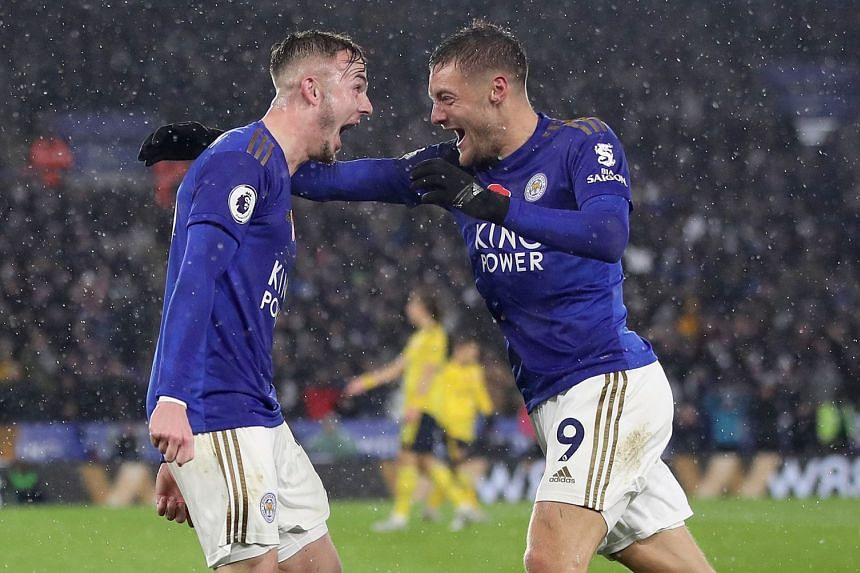 Leicester City's James Maddison (left) celebrates scoring his side's second goal with team mate Jamie Vardy.
