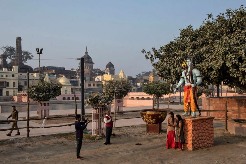 Devotees pray around a statue of Hindu Lord Ram after the Supreme Court's verdict on a disputed religious site, in Ayodhya, India, on Nov 10, 2019.