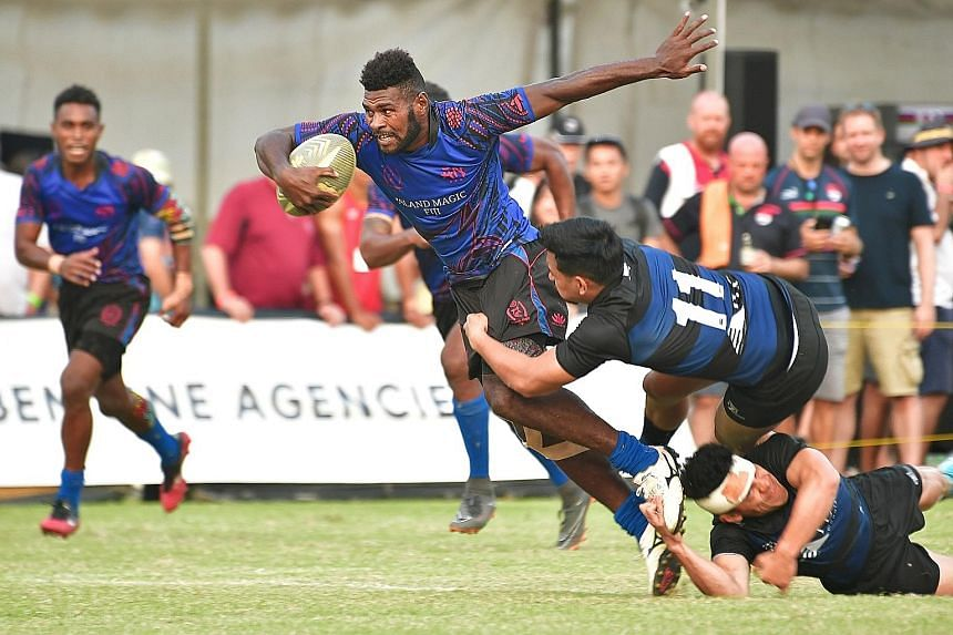 Daveta's Leveni Tani (with ball) squaring off with Ponsonby's Noah Mataia (No. 11) in yesterday's SCC International Rugby Sevens final. Ponsonby were leading 17-5 but there was late drama as the Fijians rallied in the final 150 seconds to turn the he
