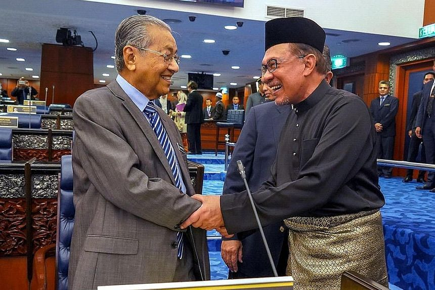 An October 2018 photo showing Malaysian Prime Minister Mahathir Mohamad with Datuk Seri Anwar Ibrahim before the latter took his oath of office as Member of Parliament. PHOTO: BERNAMA