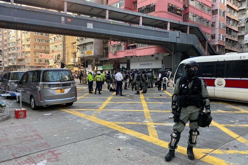 Police stand guard after a protester was shot by police in the Sai Wan Ho area of Hong Kong early on Nov 11, 2019.