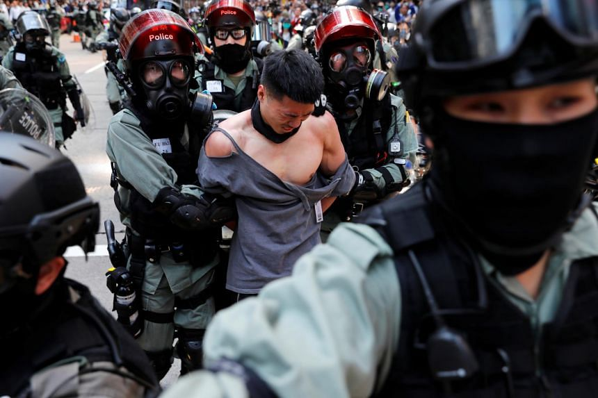 Riot police detain an anti-government protester in Central, Hong Kong, on Nov 11, 2019.