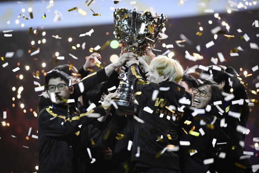 Team FunPlus Phoenix (FPX) celebrate winning the Final of League of Legends e-sport tournament between Team G2 Esports against Team FunPlus Phoenix in Accor Hotel Arena in Paris, France, on Nov 10, 2019.