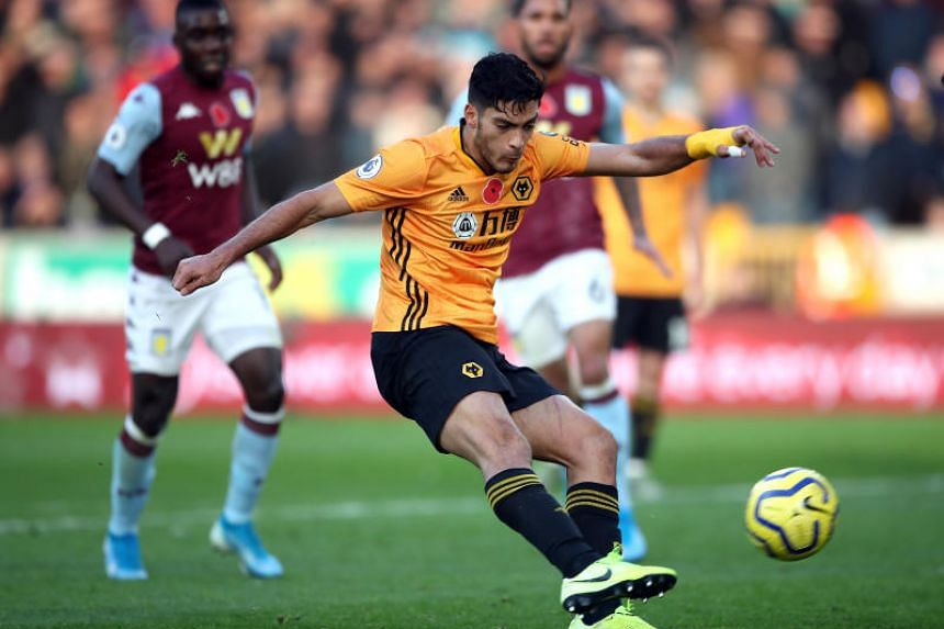 Wolverhampton Wanderers' Raul Jimenez scores his side's second goal during the English Premier League soccer match between Wolverhampton Wanderers and Aston Villa at Molineux on Nov 10, 2019.