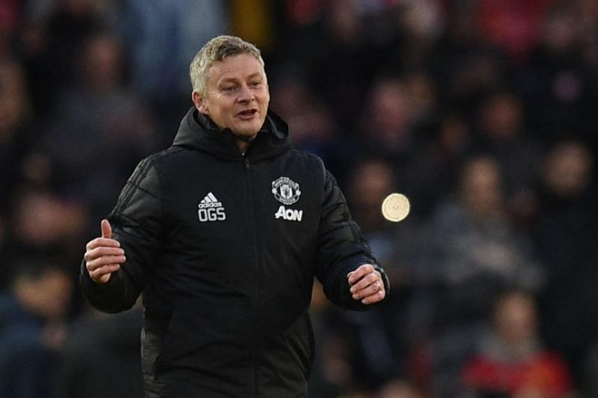 Manchester United's Norwegian manager Ole Gunnar Solskjaer applauds at the end of the English Premier League football match between Manchester United and Brighton and Hove Albion at Old Trafford in Manchester, on Nov 10, 2019.