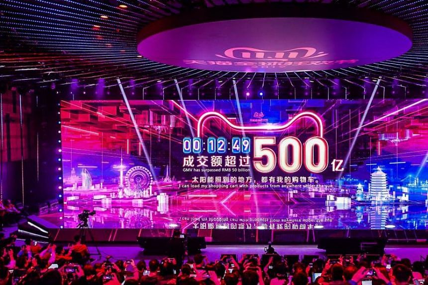 A screen shows the gross merchandise volume, a measure of sales, after 12 minutes 49 seconds of Singles Day sales, as it reaches about US$7,147,554,107 in Hangzhou in China's eastern Zhejiang province early on Nov 11, 2019.