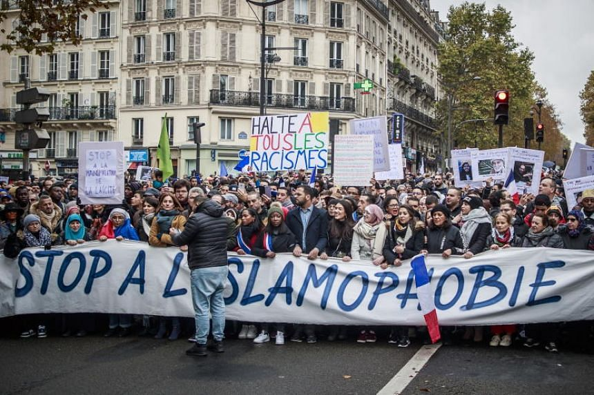 Protesters march behind a banner reading 'Stop to Islamophobia', as people and members of anti-racism associations gather to protest against Islamophobia at the Gare du Nord in Paris, France, on Nov 10, 2019.
