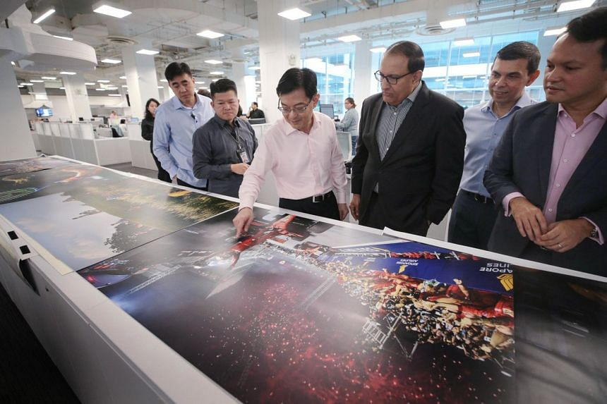 (From right) Minister of State for Manpower and National Development Zaqy Mohamad, ST editor Warren Fernandez, Minister for Communications and Information S. Iswaran and Deputy Prime Minister Heng Swee Keat during a tour of the ST newsroom on Nov 11,