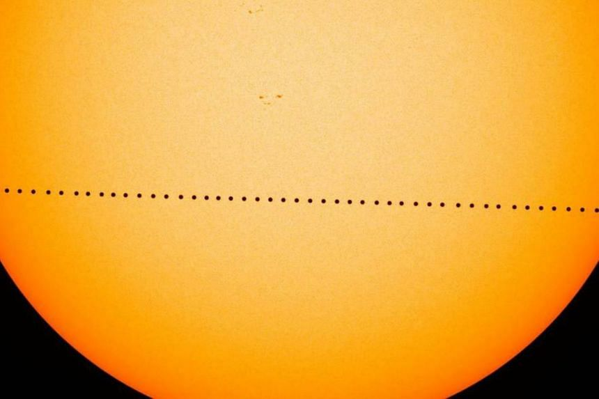 A composite photo shows the most recent transit of Mercury, on May 9, 2016.