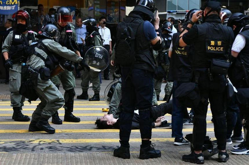 A man is detained by police during a protest in Hong Kong's Central district on Nov 11, 2019.