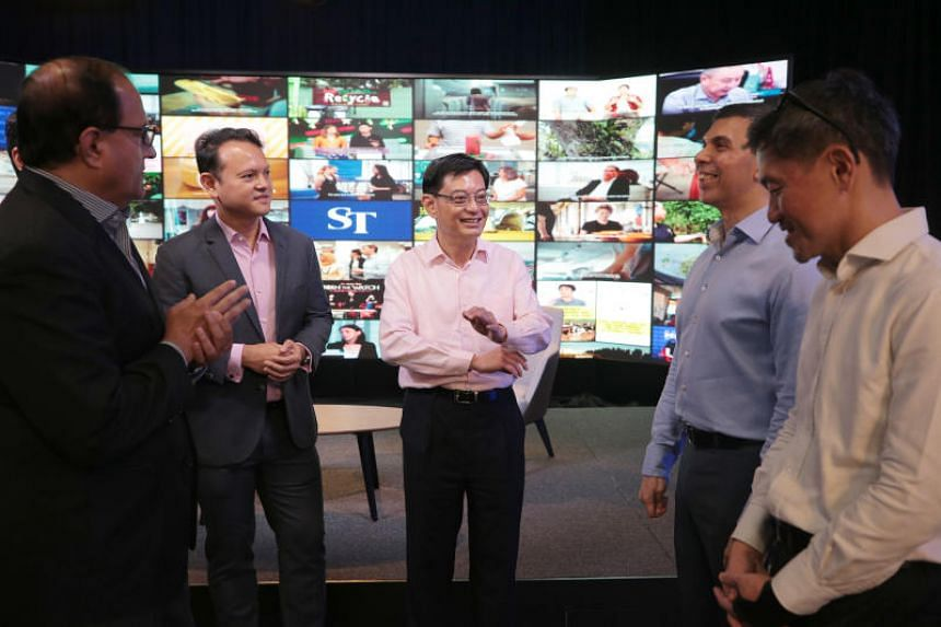 (From left) Minister for Communications and Information S. Iswaran, Minister of State for Manpower and National Development Zaqy Mohamad, Deputy Prime Minister Heng Swee Keat, ST editor Warren Fernandez and SPH deputy CEO Anthony Tan during a tour of