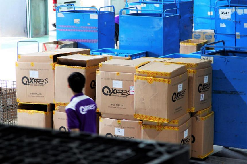 In this file picture, an employee is seen at Qxpress, Qoo10's sorting and delivery facility in Toh Guan. Qoo10 said orders and sales in the first hour of this year's Singles' Day were five times more than last year.